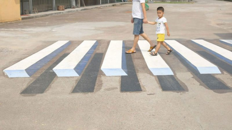 Optical Illusions Painted on the Road Fool Drivers to Slow Down